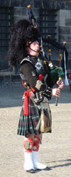 Bagpipe performer wearing a kilt